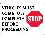 VEHICLES MUST COME TO A COMPLETE STOP BEFORE PROCEEDING SIGN