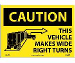 CAUTION THIS VEHICLE MAKE WIDE RIGHT TURNS SIGN