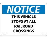 NOTICE THIS VEHICLE STOPS AT ALL RAILROAD CROSSINGS SIGN